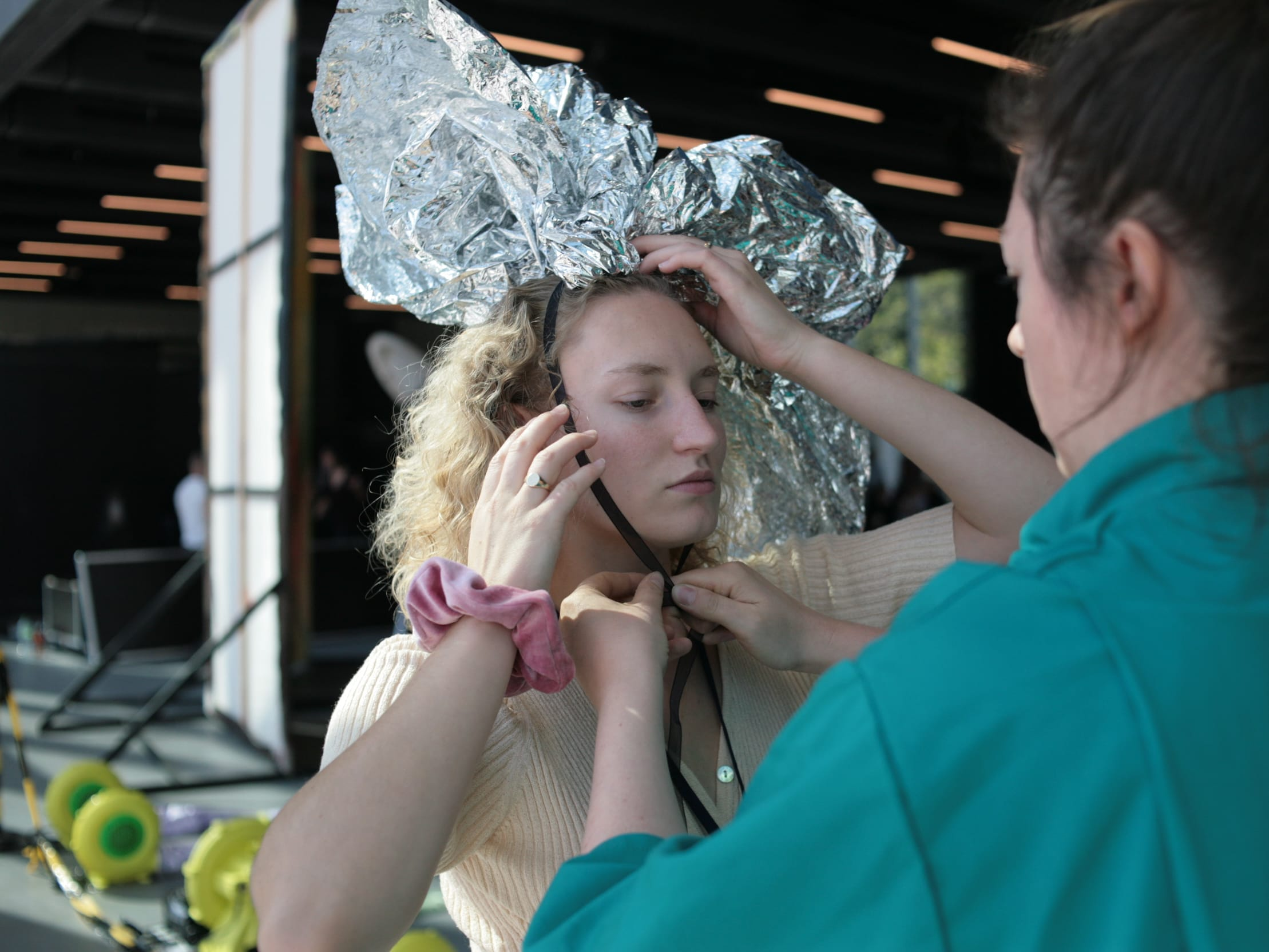 Student with tin foil hat getting ready for performance during the Bauhaus celebrations in Dessau, Germany.