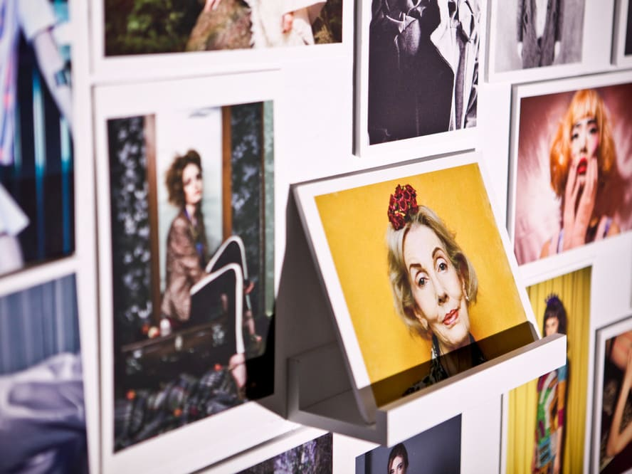 A collection of polaroid photographs on wall  taken by students at London College of Fashion