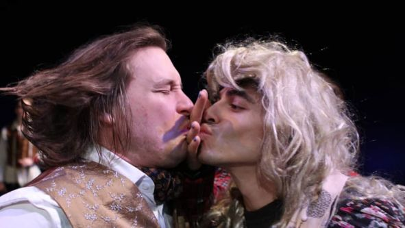 Two men on stage pretending to kiss, Midsummer Night's Dream performance, MA Acting, CSM, 2012.