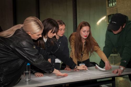 Students organising cut up pieces of paper