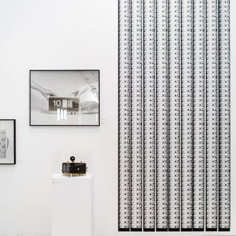 Installation view of a large-scale black and white print and photograph by Lam Pok Yin & Jeff Chong Ng