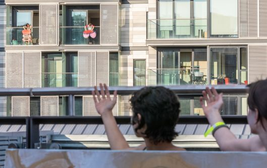 Performance with two people standing on balconies in distance