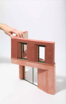 a building scaled down model in plaster, which used a 3d printed model to create a cast