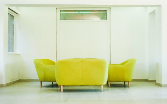 Photo of a group of green sofas in a communal area at Furzedown Student Village