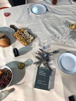 A table arranged with food items and tableware