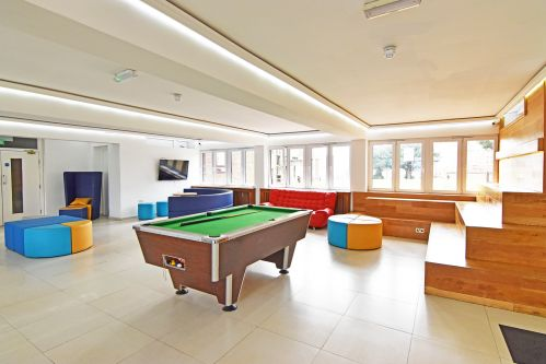 Furzedown Common Room with lots of modern seating, pool table and party lighting