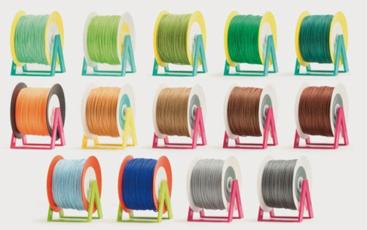 multiple rolls of filament (PLA) in various colours across 3 rows
