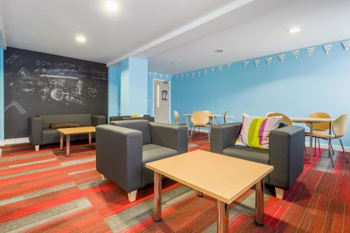 Photo of a communal area with chairs and a table at Don Gratton House