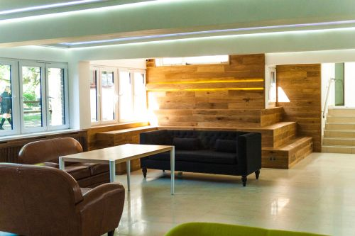 Photo of a communal area with sofas and tables at Furzedown Student Village
