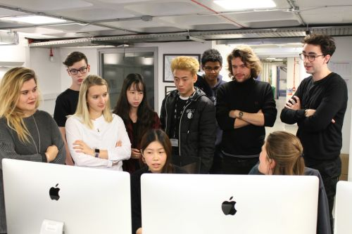 Students take part in group crit
