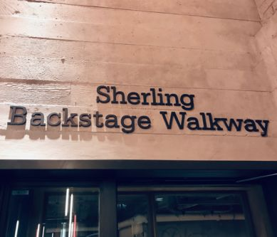 A photograph of a sign 'Sherling Backsatge Walkway'
