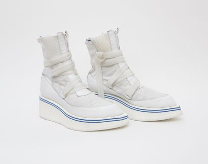 White boots against white background
