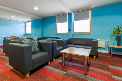 Photo of a communal area with sofas at Don Gratton House
