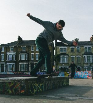 A photograph of a skateboarder.