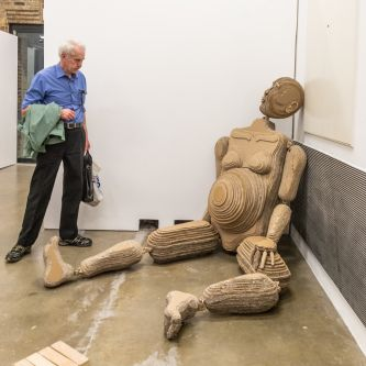 Man looking at sculpture