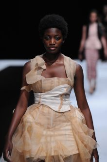 Model with creamy, romantic dress designed by Rosie D'Ercole