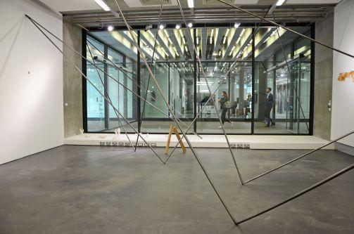 Metal poles fixed to walls at angles
