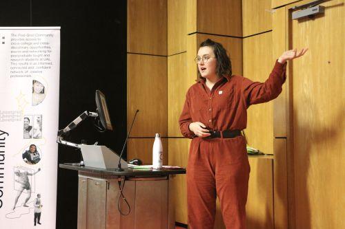 female speaker in lecture theatre