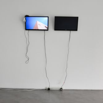 two tv screens in a gallery