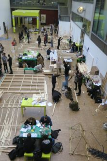 Students working on architectural structures in The Street at Central Saint Martins