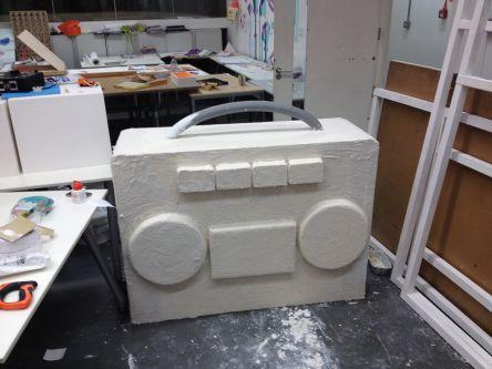 White plaster sculpture of a stereo speaker