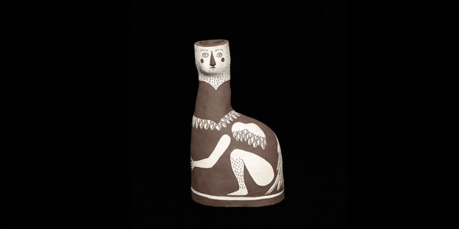 A ceramic vase which depicts a mythological bird figure