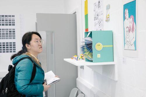 student observing art