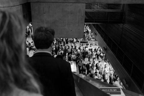 people in a crowd walking down a street