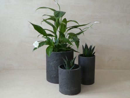 Three different sized, black plant pots