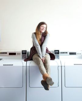 Photo of a student sitting on a washing machine