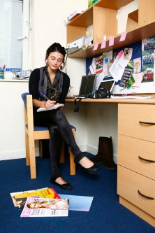 Photo of a female student sitting at a desk in a bedroom at Manna Ash House