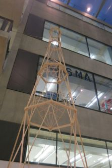 A tower made from pieces of wood on display in The Street at Central Saint Martins