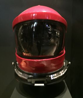 An image of a red space helmet