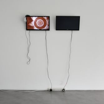 two screens in a gallery