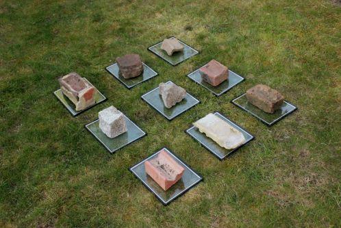bricks on glass plates on grass