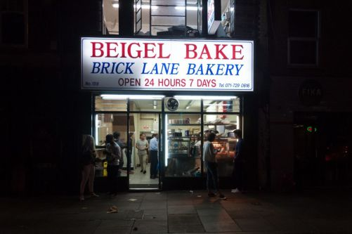 the exterior of beigel bake at night