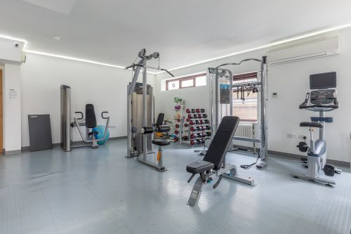 Spacious gym with lots of equipment