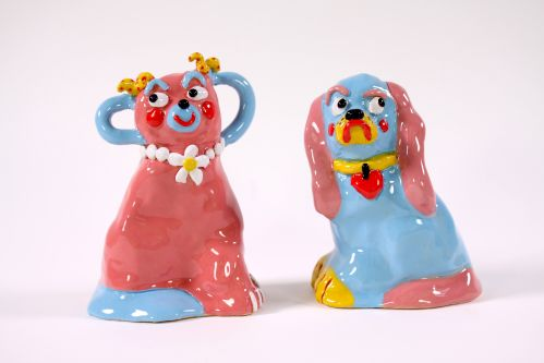 Two ceramic dogs in pink and blue