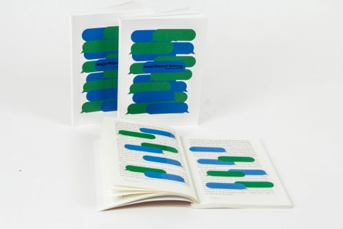 View of an open and closed book. The front cover shows a pattern made up of long horizontal blue and green speech bubbles. The inside view shows text overlaid with the same blue and green speech bubbles.