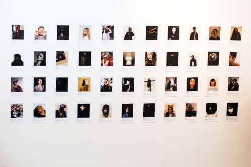 A grid of 46 polaroid photographs of each of the graduating students in the show.