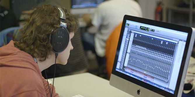 A student working on Pro Tools in the Large Sound Room.
