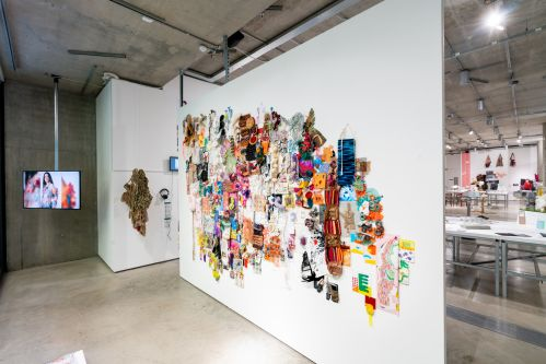 Textile work displayed on a gallery wall