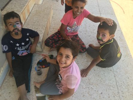 Four children from jordan playing with arts and crafts