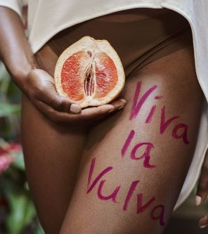grapefruit held in front of womans crotch