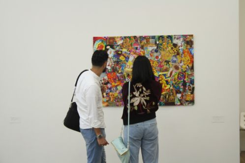 people looking at a painting