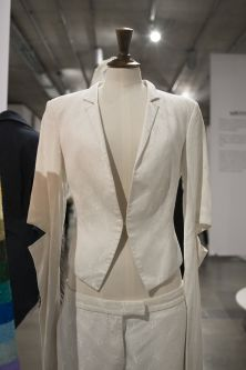 Detail of white suit and trousers on mannequin