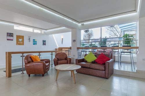 Common room entrance with seating and soft furnishings