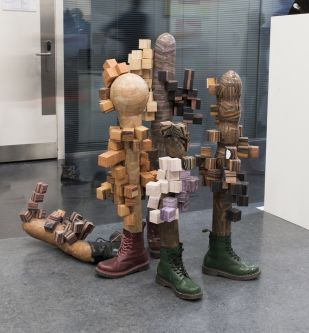 a sculpture of 4 wooden legs in boots