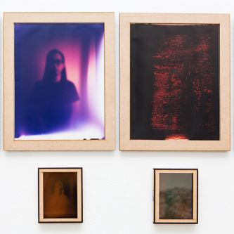 Four photographs with red and pink tones of blurred figures by Lik Shan Jan Eric Wong.