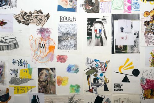 A wall of rough sketches, drawings and collages.